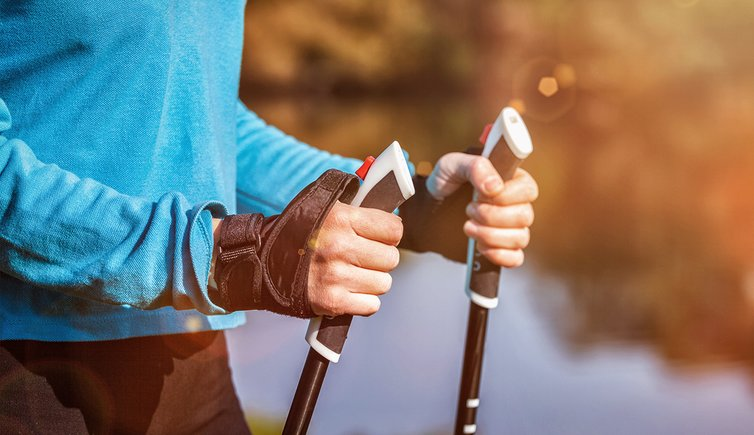 Adobe Stock nordic walking wander stoecke person