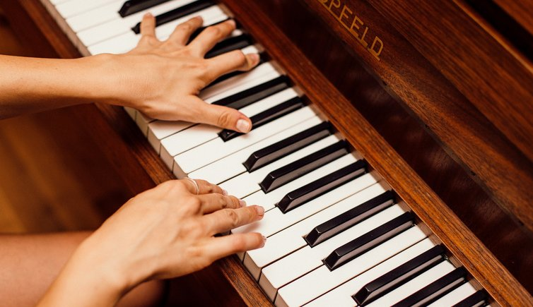 close up photo of person playing piano